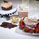 Chocolate Macadamia Nut Cheesecake Mix prepared as a cheesecake or dip with strawberries